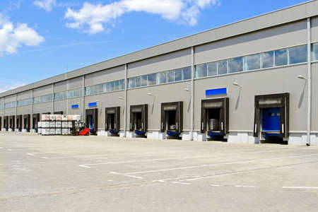 on ramp: Cargo doors at big industrial warehouse building