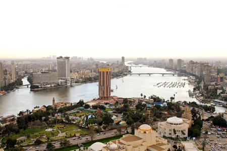 cairo: CAIRO, EGYPT - FEBRUAR 25: Cairo city from tower on FEBRUAR 25, 2010. City and bridge at River Nile in Cairo, Egypt.