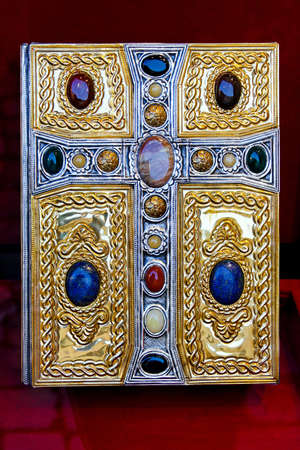 roman catholic: Holy Bible book in gold with cross and diamonds