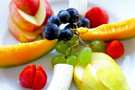 Variety of fresh fruits served at plate  photo