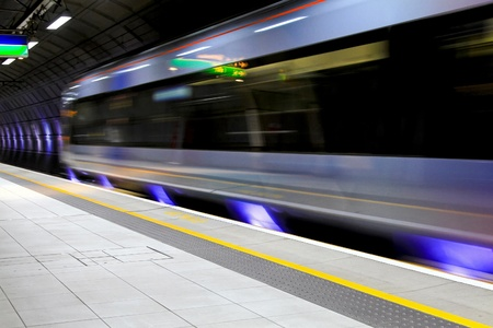 rails: Modern speed train moving through underground station  Stock Photo