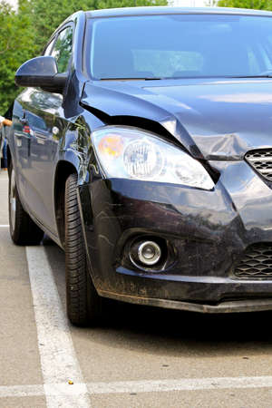 damages: Hood and bumper damage at new car  Stock Photo