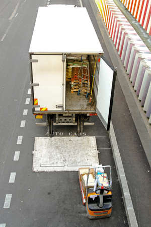 distributing: Commercial good delivery truck and forklift vehicle