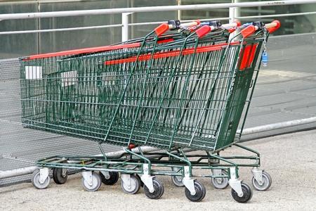 Several empty shopping carts at supermarket parking  photo