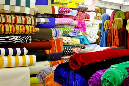 Assortment of colourful textile fabric rolls in warehouse Stock Photo - 8906052