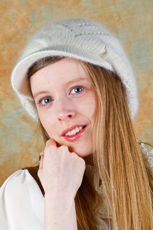 Young blonde teenage girl with white wool hat  Stock Photo - 8906061