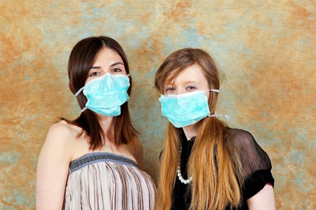 Two young women with protective medical masks photo