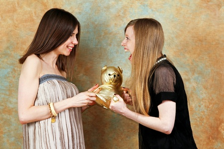 fighting styles: Two girls fighting for golden teddy bear