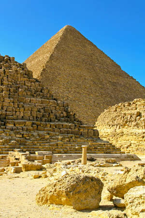 ruins is ancient: Pyramid Khufu and old tombs in Egypt