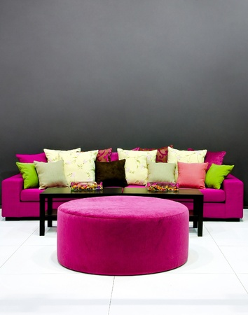 Purple Sofa With Pillows In Dark Room Stock Photo, Picture And Royalty Free  Image. Image 9094949.