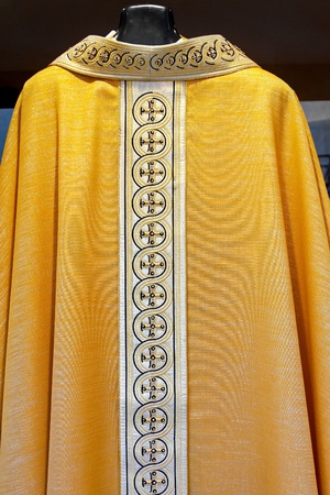 Golden mantle for Catholic priest with cross pattern  Stock Photo - 9095379