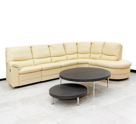 settee: Beige leather settee in corner of living room