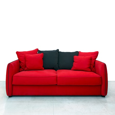 Red sofa with pillows in living room  photo