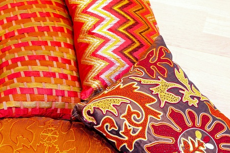red pillows: Big pile of colorful pillows and bedding