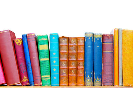 Used grunge colourful books at library shelf  Stock Photo - 9149946