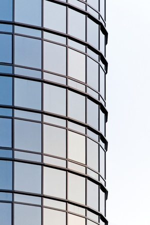 Oval business skyscraper with blue glass windows  photo