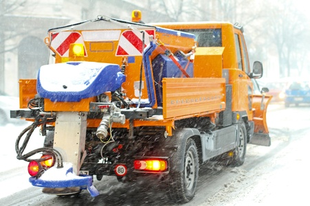 Snow plough truck with salt and grit spreader  photo