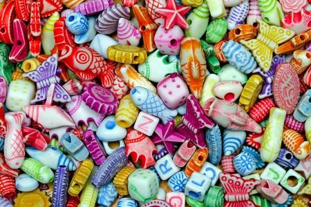 bijoux: Multi color plastic beads variety assortment background
