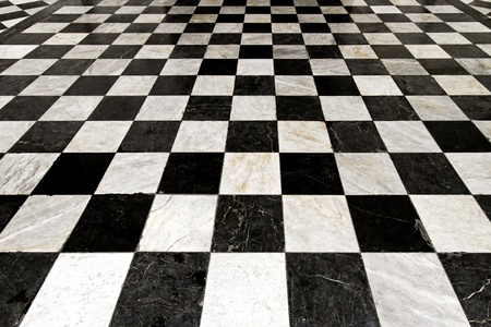 tile flooring: Black and white tiles in checkers pattern