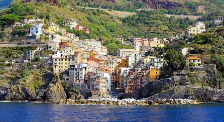 Colorful town of Riomaggiore at Cinque Terre Liguria coast  photo