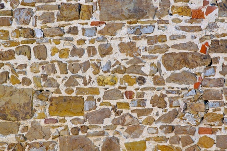Very old stone wall from medieval Tuscany Stock Photo - 9243178