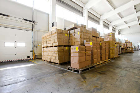 Big pile of boxes in distribution storehouse  photo