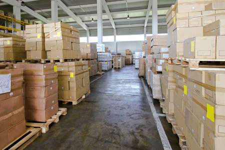 storage box: Corridor in warehouse with lot of boxes