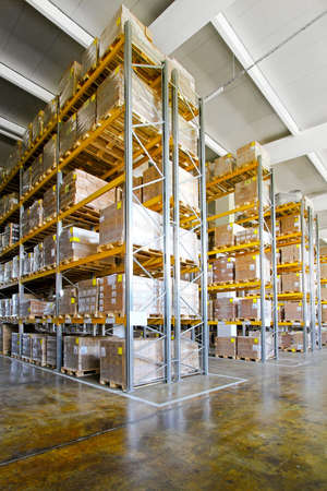 shipping boxes: Tall shelves and racks in distribution warehouse  Stock Photo