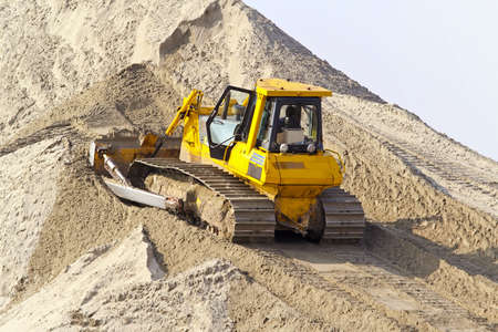 construction machinery: Bulldozer with track move sand at construction site