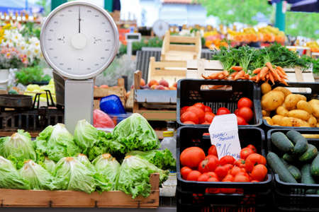 fruit stand: Analog scale and vegetables at farmers market