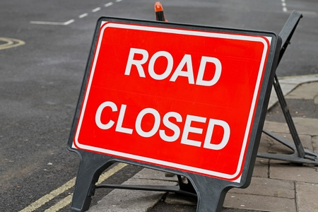 road works: Road closed red sign for construction works   Stock Photo