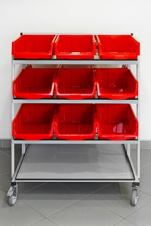 Supply cart with plastic red boxes for storehouse  photo