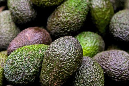 avocados: Big bunch of avocados at farmer market  Stock Photo