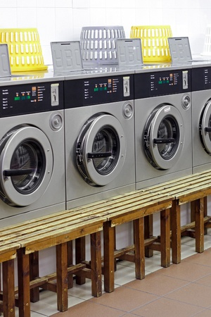 operated: Coin operated washing machines in laundry shop