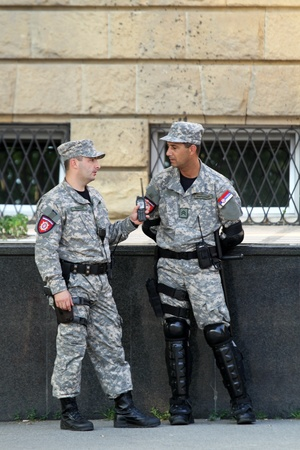 tribunal: BELGRADE, SERBIA - MAY 26: Two policeman in front of courthouse for war crimes with arrested Ratko Mladic at MAY 26, 2011. Two special police officers in front of tribunal building in Belgrade, Serbia.
