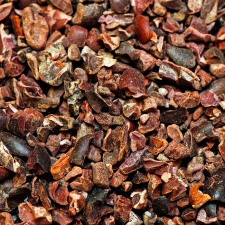 nib: Bunch of raw organic crushed cocoa nibs  Stock Photo