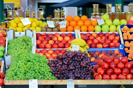 Fresh fruits and vegetables at farmers market stall Stock Photo