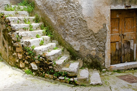 derelict: Old stone stairway at abandoned derelict house