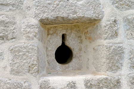 loophole: Loophole in wall at medieval castle fortification