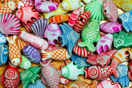 toy fish: Color assortment of sea life plastic beads Stock Photo