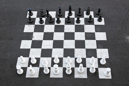 Outdoor chess game and big chequer board photo