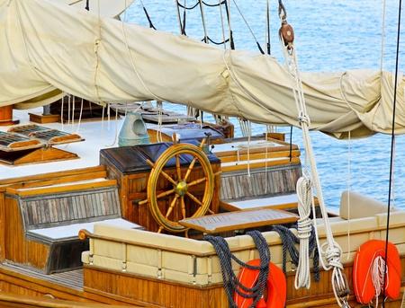 wheelhouse: Old sail ship deck with wooden wheel Stock Photo