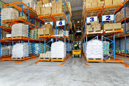 storage box: Distribution warehouse interior with racks and shelves