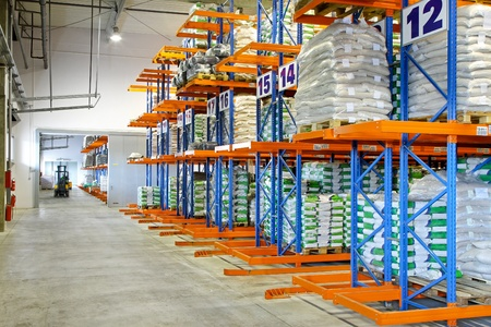 Distribution warehouse interior with racks and shelves photo