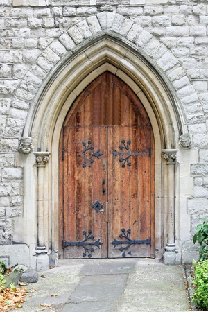 wooden facade: Old door on ancient Christian Protestant church Stock Photo