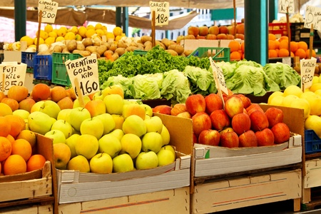 Fresh fruits at stall in farmers market photo