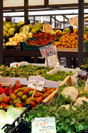 Organic vegetables at stall in farmers market photo