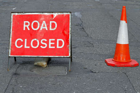 traffic cones: Sign on a street closed for road reconstruction