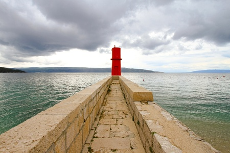 adriatic: Red lighthouse tower at island Cres in Adriatic sea