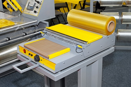foil roll: Machine for packaging in thermo foil plastic Stock Photo